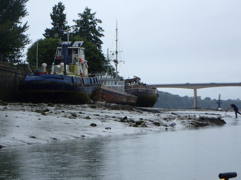 Tugs at Bideford - owner trying to dig a channel to flush out his tug next tide