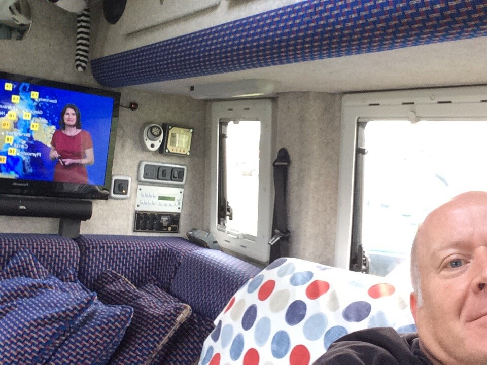 Half smug selfie, warm and dry watching telly in my van