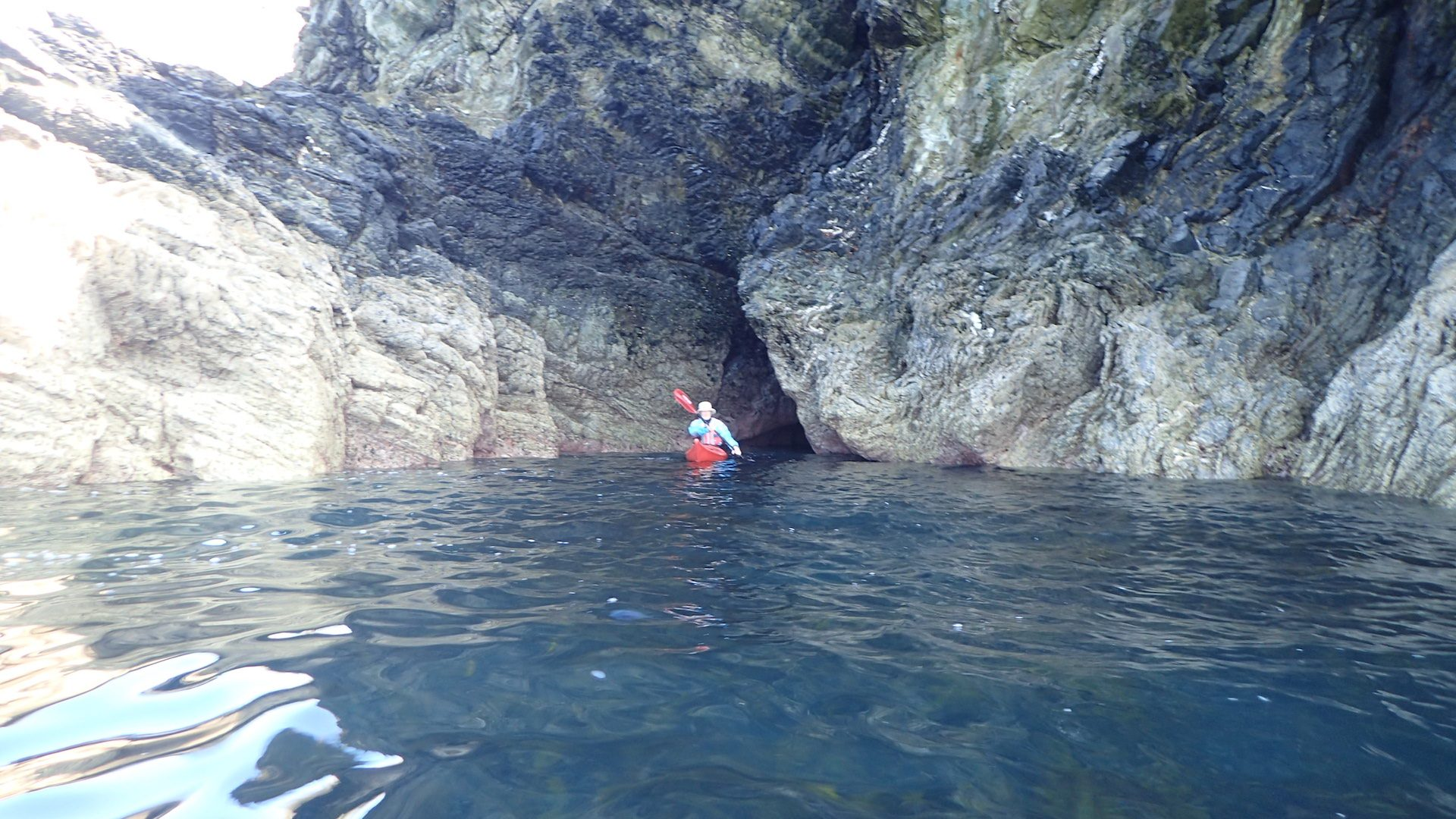 Blow hole cave at low water with Owain